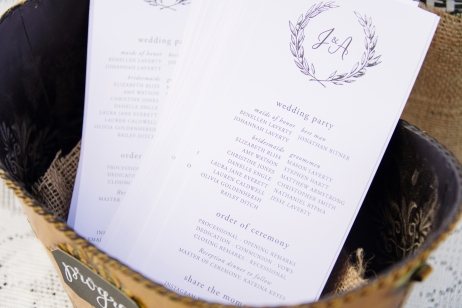 - AMY ROCHELLE PRESS - Wedding program with crest / olive wreathe monogram. Photography: Images by Bethany.