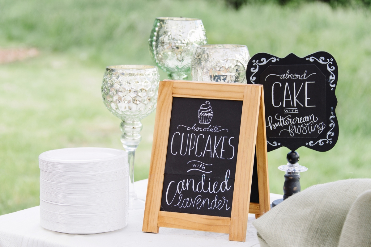 - AMY ROCHELLE PRESS - Chocolate cupcakes with candied lavender. Chalkboard Wedding Signs with illustrated cupcake and hand lettering. Photo by Images by Bethany