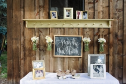 - AMY ROCHELLE PRESS - Sign the Guestbook Chalk Board Sign with wild picked daisies from the river. Photo by Images by Bethany