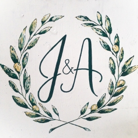 - AMY ROCHELLE PRESS - Hand painted sign with olive wreathe monogram for outdoor event design