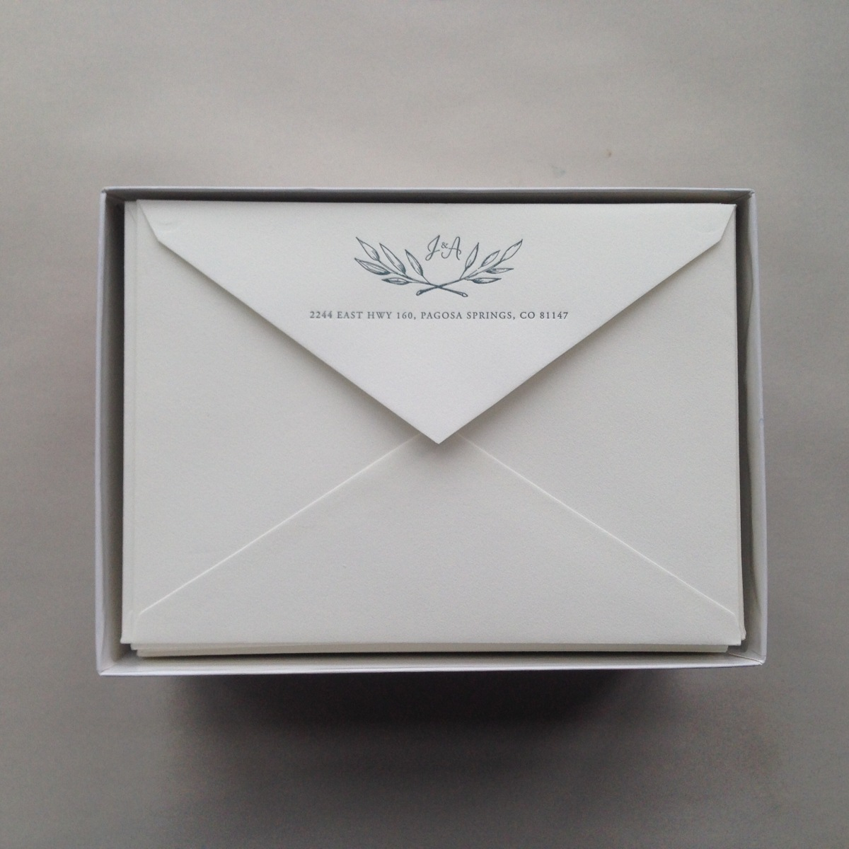 - AMY ROCHELLE PRESS - Letterpress wedding envelopes with olive wreathe and monogram on Crane's Lettra. Part of a custom wedding invitation suite.