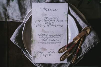 - AMY ROCHELLE PRESS - Detail view of menus with deckled edges, pearl accents, and soft gray and emerald ink. Photo by Eva Kosmas Flores