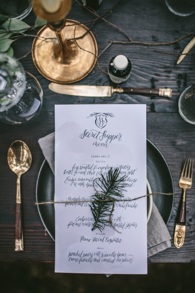 - AMY ROCHELLE PRESS - Fire and Ice Secret Supper. Hand lettered menus with taupe watercolor washes and a simple pine crest. Photo by Eva Kosmas Flores